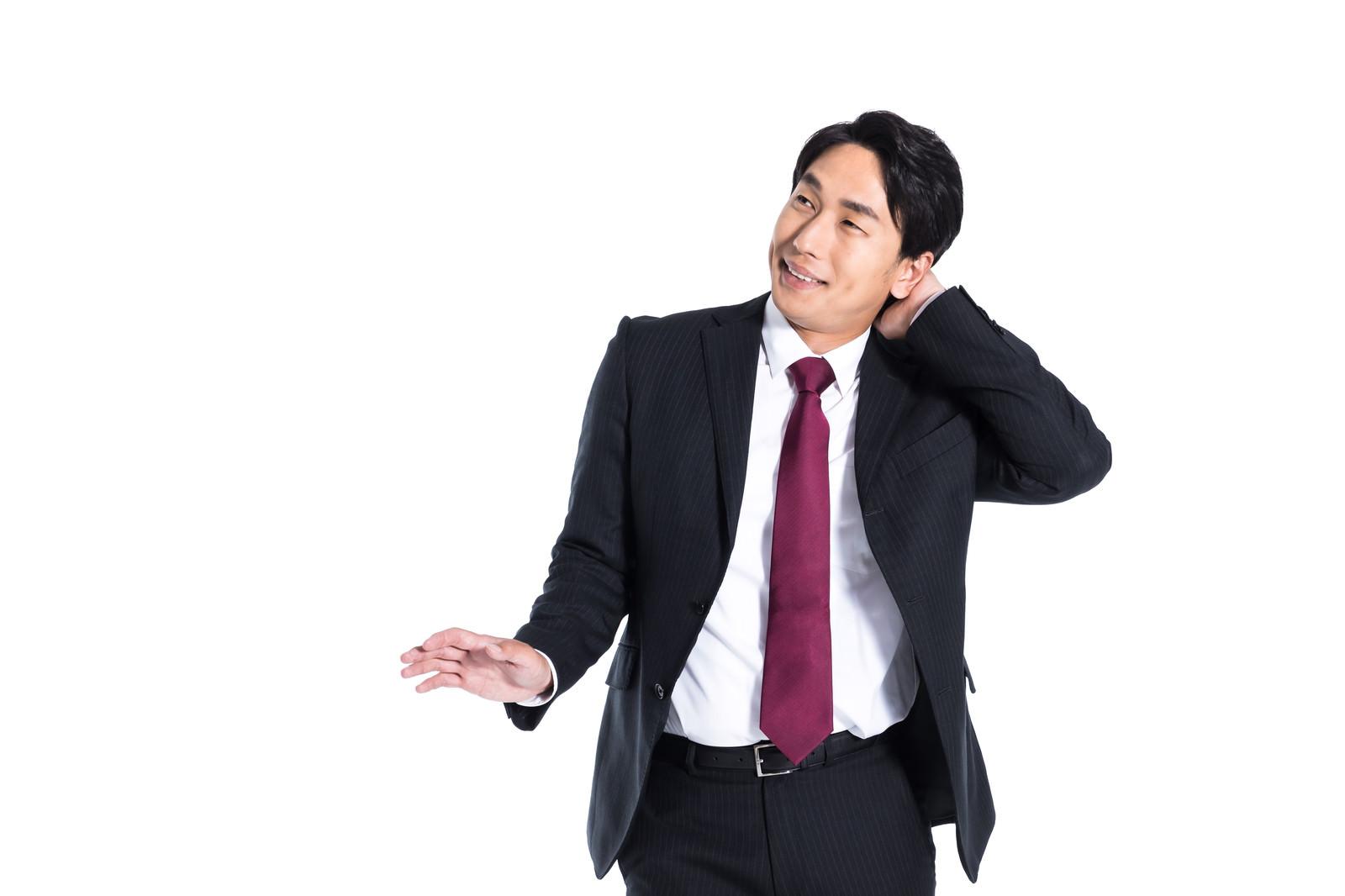 「遠慮する会社員」の写真[モデル:大川竜弥]