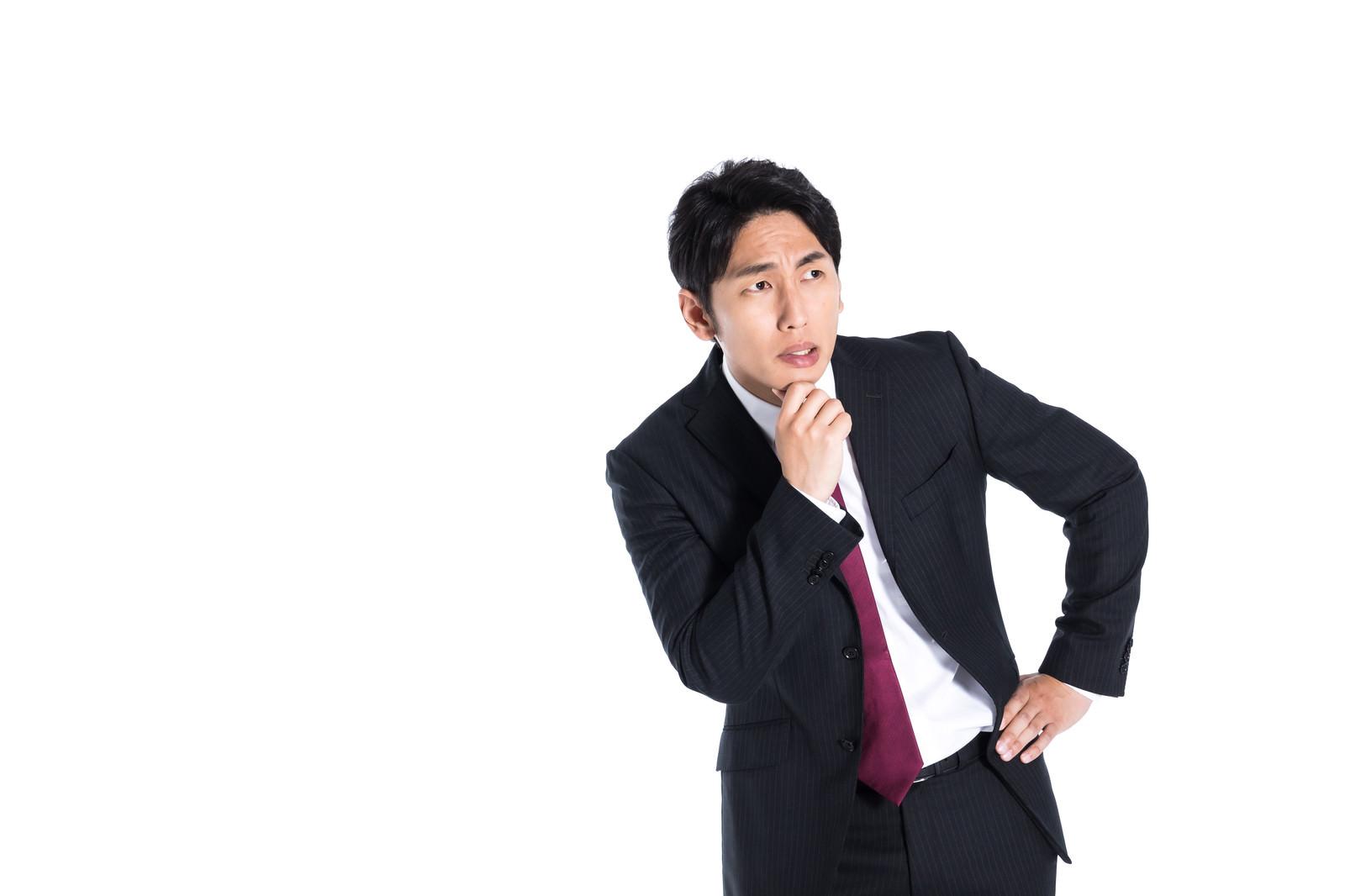 「業績を不安視するエリート」の写真[モデル:大川竜弥]