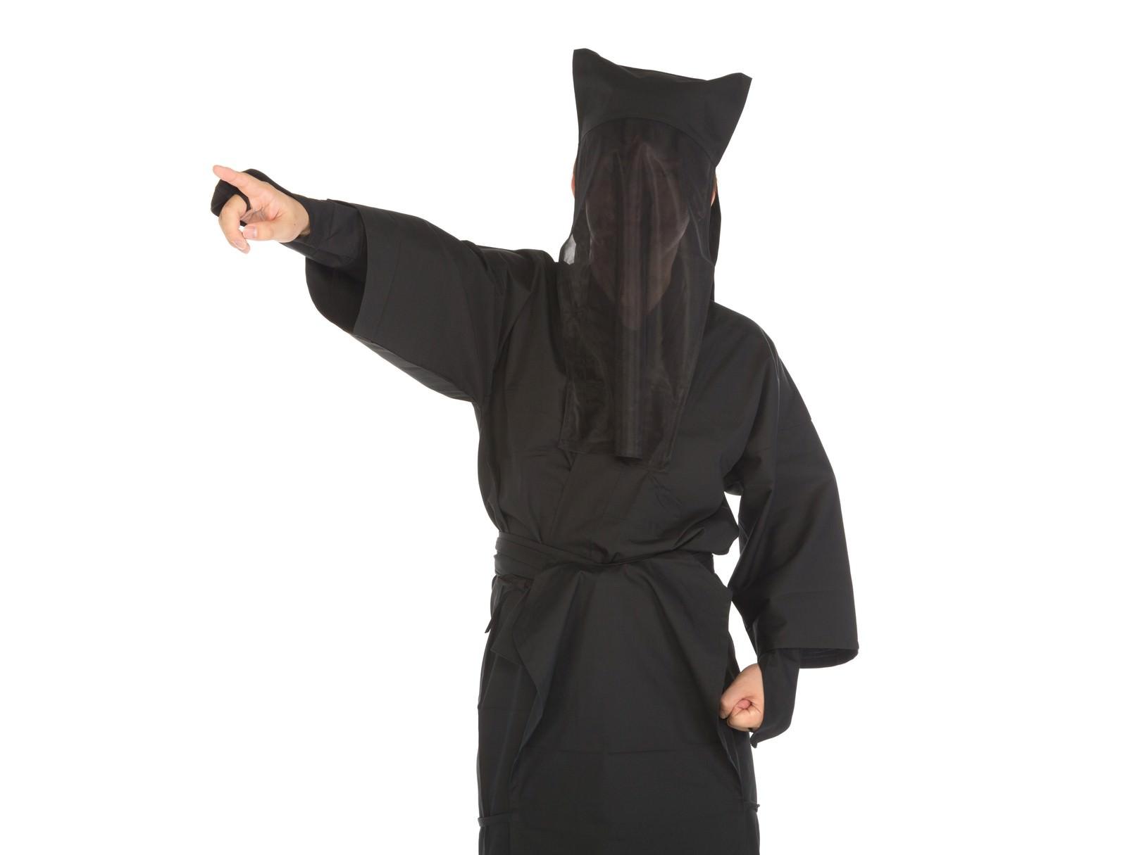「遠くを指さす黒子」の写真[モデル:鈴木秀]