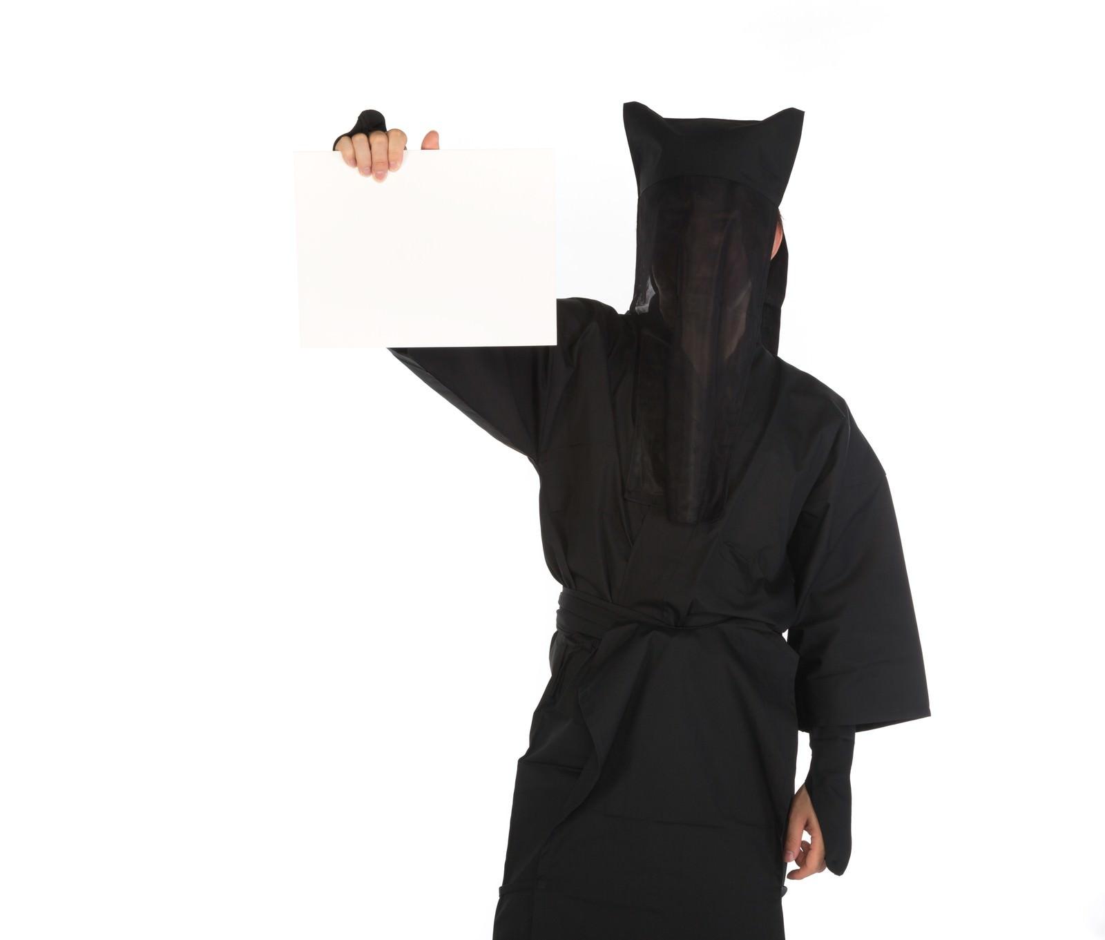 「カンペを持った黒子」の写真[モデル:鈴木秀]