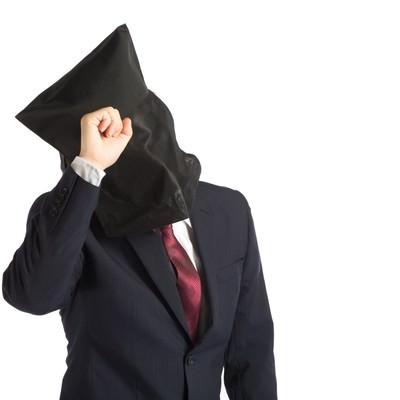「悩んでも解決しない黒子社員」の写真素材