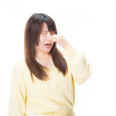「「くっさーーい!」と悲鳴をあげる女性」の写真素材