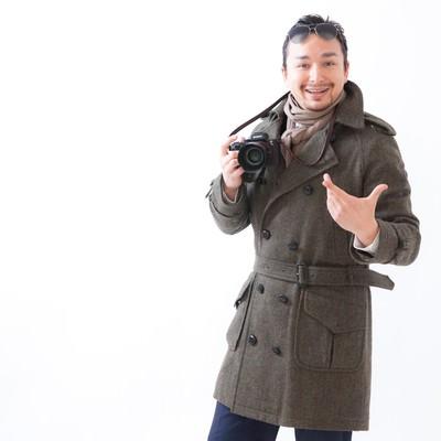 「コートを着た外国人観光客」の写真素材