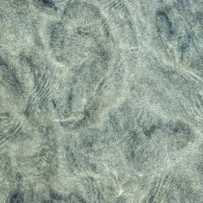 「海水と砂紋の模様」の写真素材