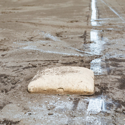 「三塁ベースと白線(野球練習中)」の写真素材