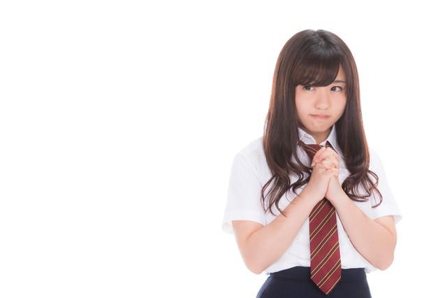 奇跡を信じる女子高生の写真