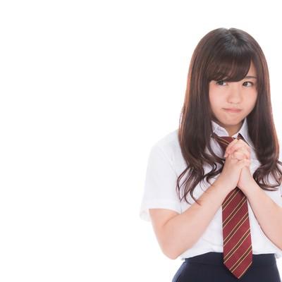 「奇跡を信じる女子高生」の写真素材