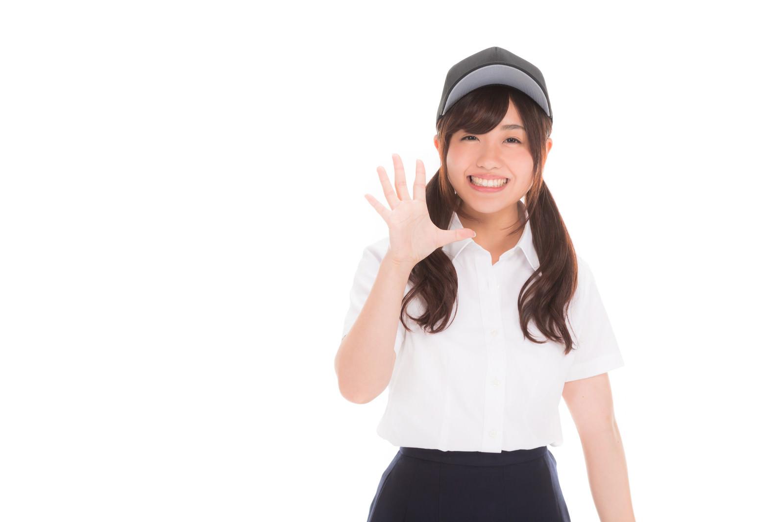 「笑顔で挨拶を返してくれる女子マネ」の写真[モデル:河村友歌]