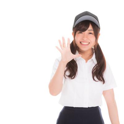 「笑顔で挨拶を返してくれる女子マネ」の写真素材