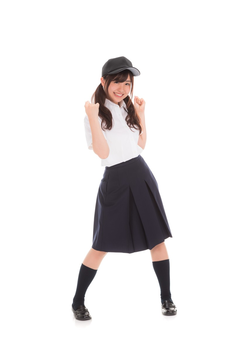 「立ち上がって応援する女子マネ」の写真[モデル:河村友歌]