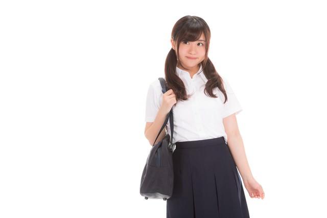 そわそわする女子高生の写真