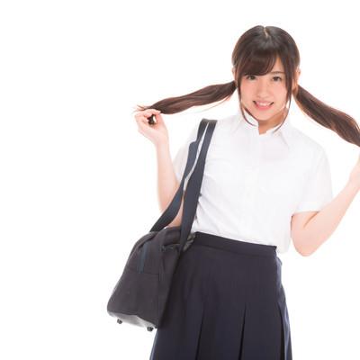 「ちょっぴり照れる女子高生」の写真素材