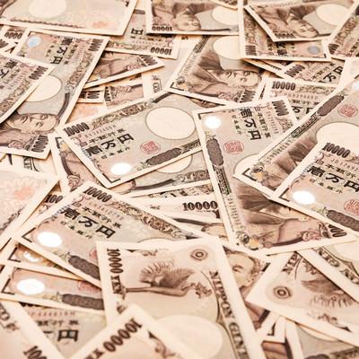 1万円札をばらまくの写真