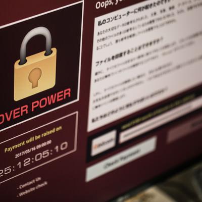 「暗号化解除に身代金を要求する不正プログラム」の写真素材