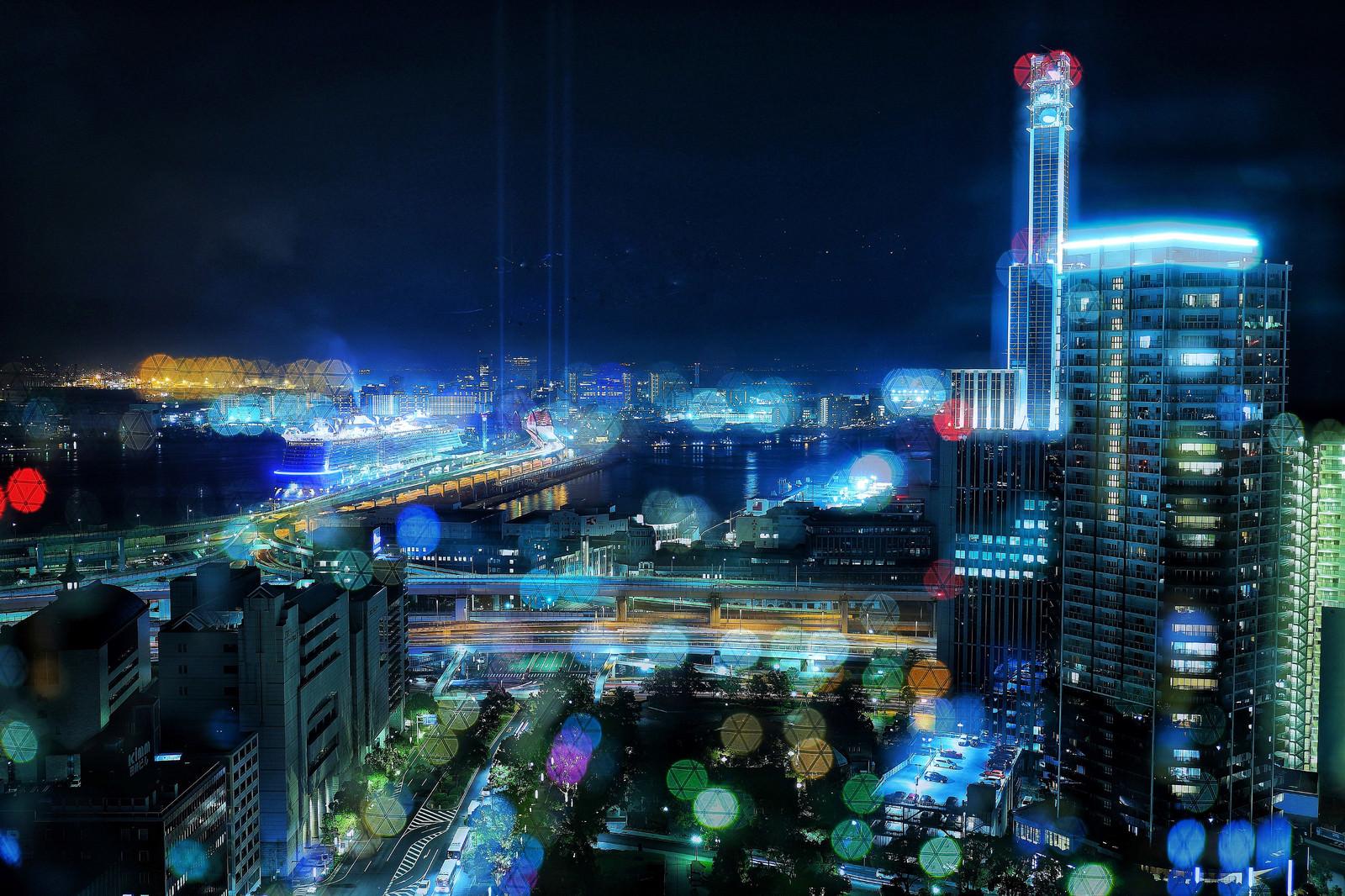 「カラフルなボケと都市夜景」の写真