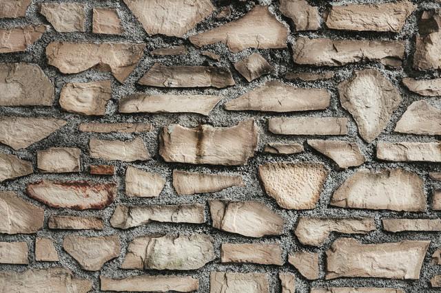 割れたレンガで造られた壁(テクスチャ)の写真