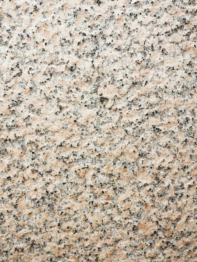 細かい点々が散らばる石材(テクスチャ)の写真