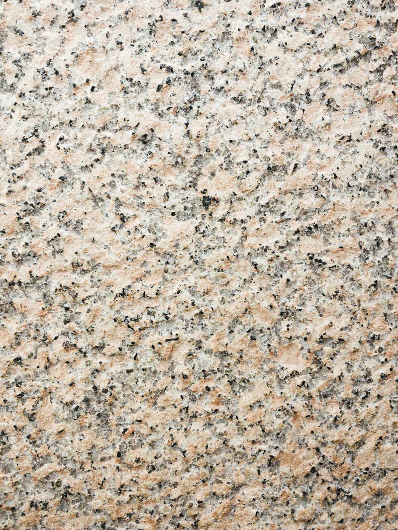 「細かい点々が散らばる石材(テクスチャ)」の写真