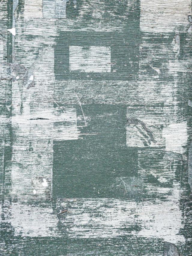 テープ跡が付いたベニヤ板(テクスチャ)の写真