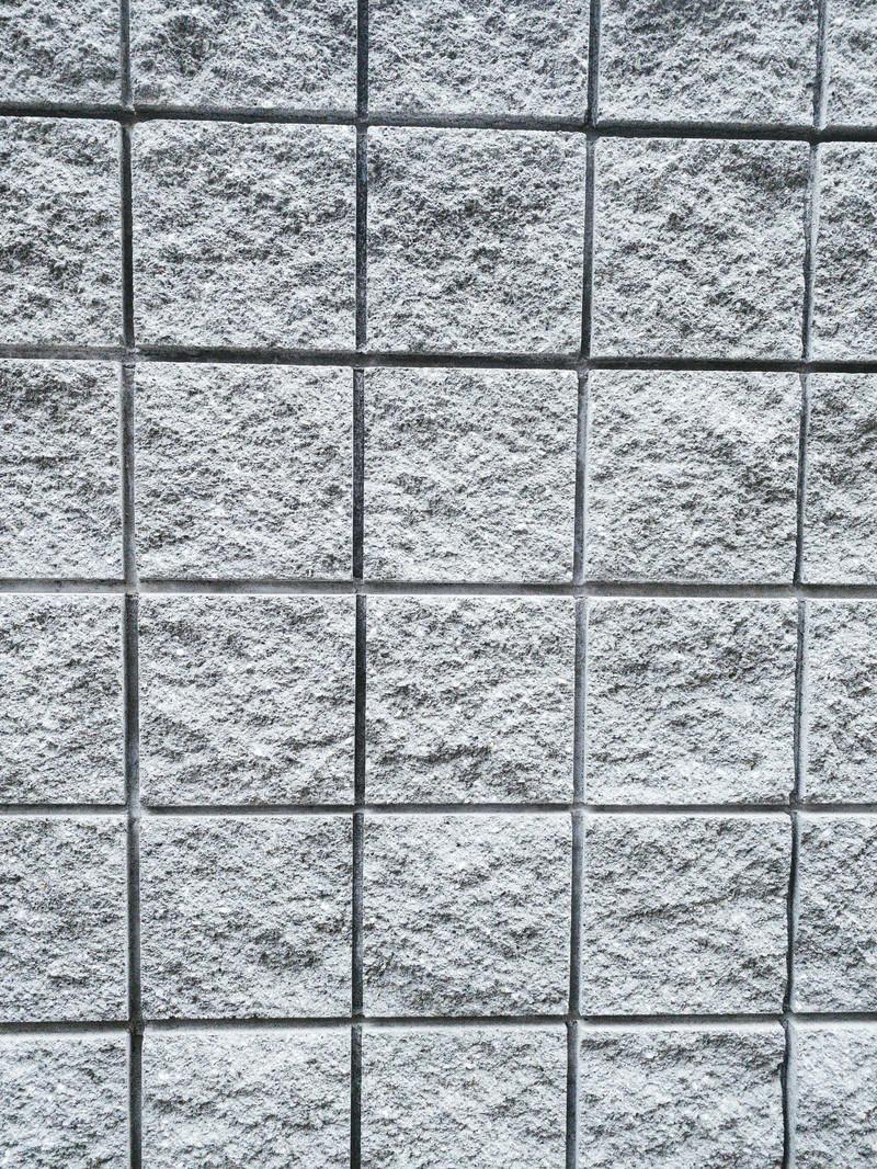 「表面に凹凸のある正方形のタイル(テクスチャ)」の写真