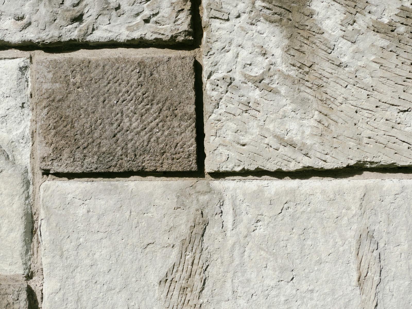 「タイル調のセメント仕上げの壁(テクスチャ)」の写真