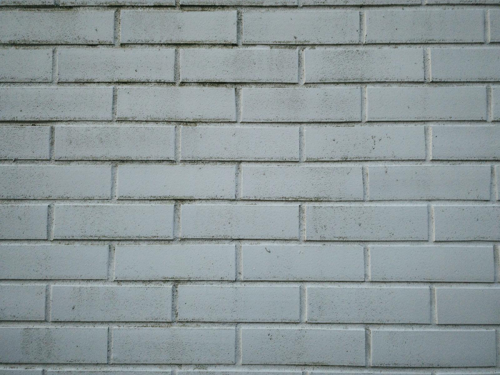 「一色に塗られた煉瓦の壁(テクスチャ)」の写真