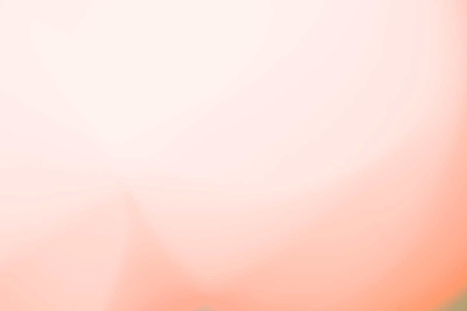 「オレンジ色のグラデーション背景」の写真