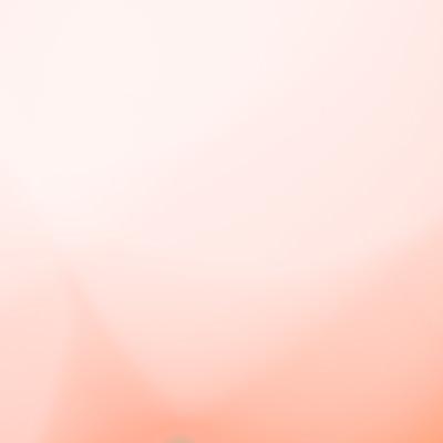 「オレンジ色のグラデーション背景」の写真素材