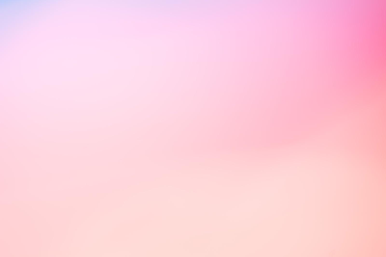 「ピンク色の背景(グラデーション)」の写真