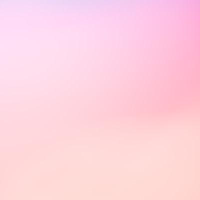 ピンク色のボケた光の写真