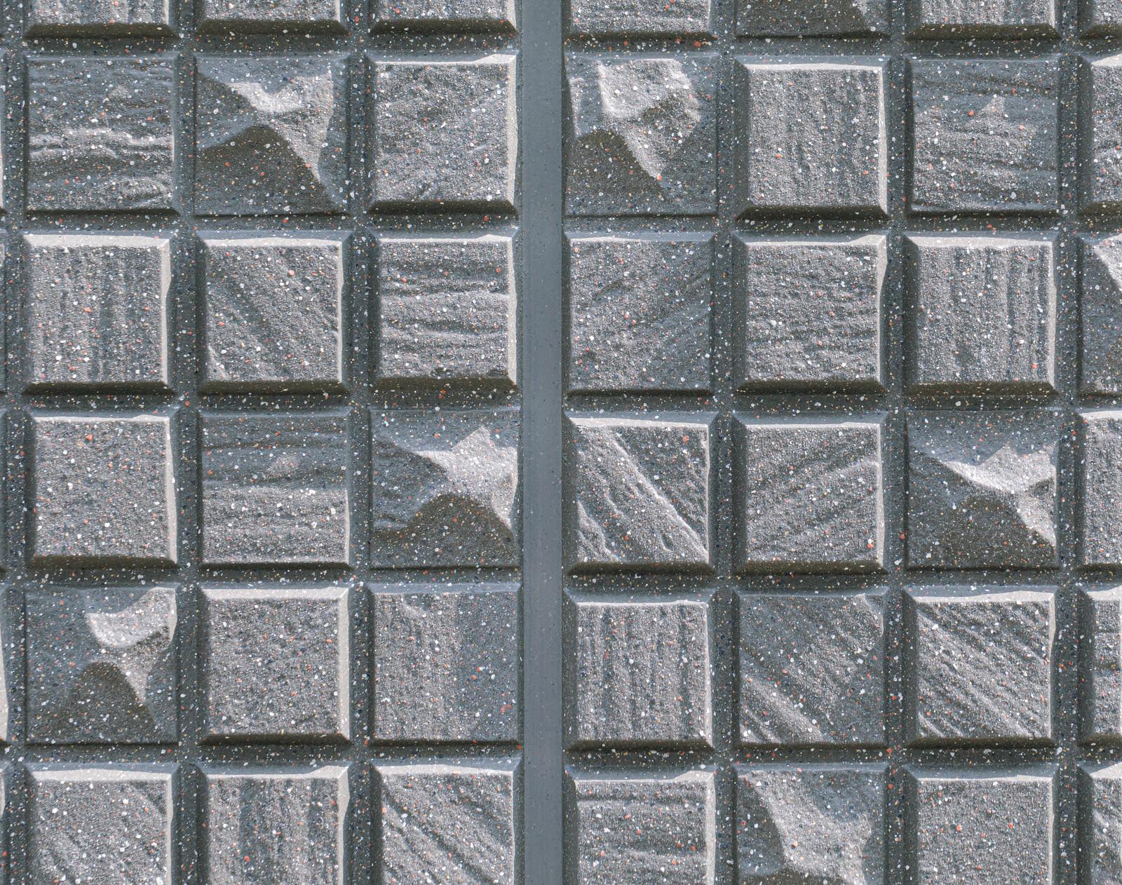 「正方形のいびつなタイル(テクスチャ)」の写真