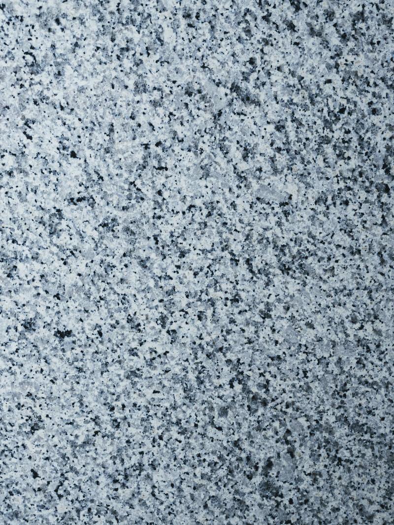 「文字が浮かび上がりそうな石材タイル(テクスチャ)」の写真