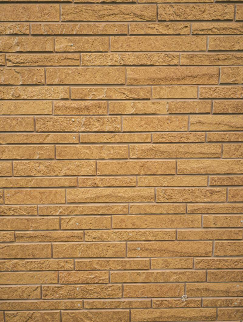 「茶色いレンガ風の壁」の写真