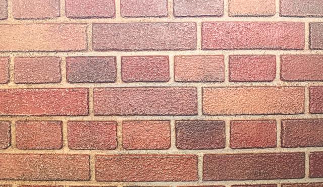 形の違うレンガの壁の写真