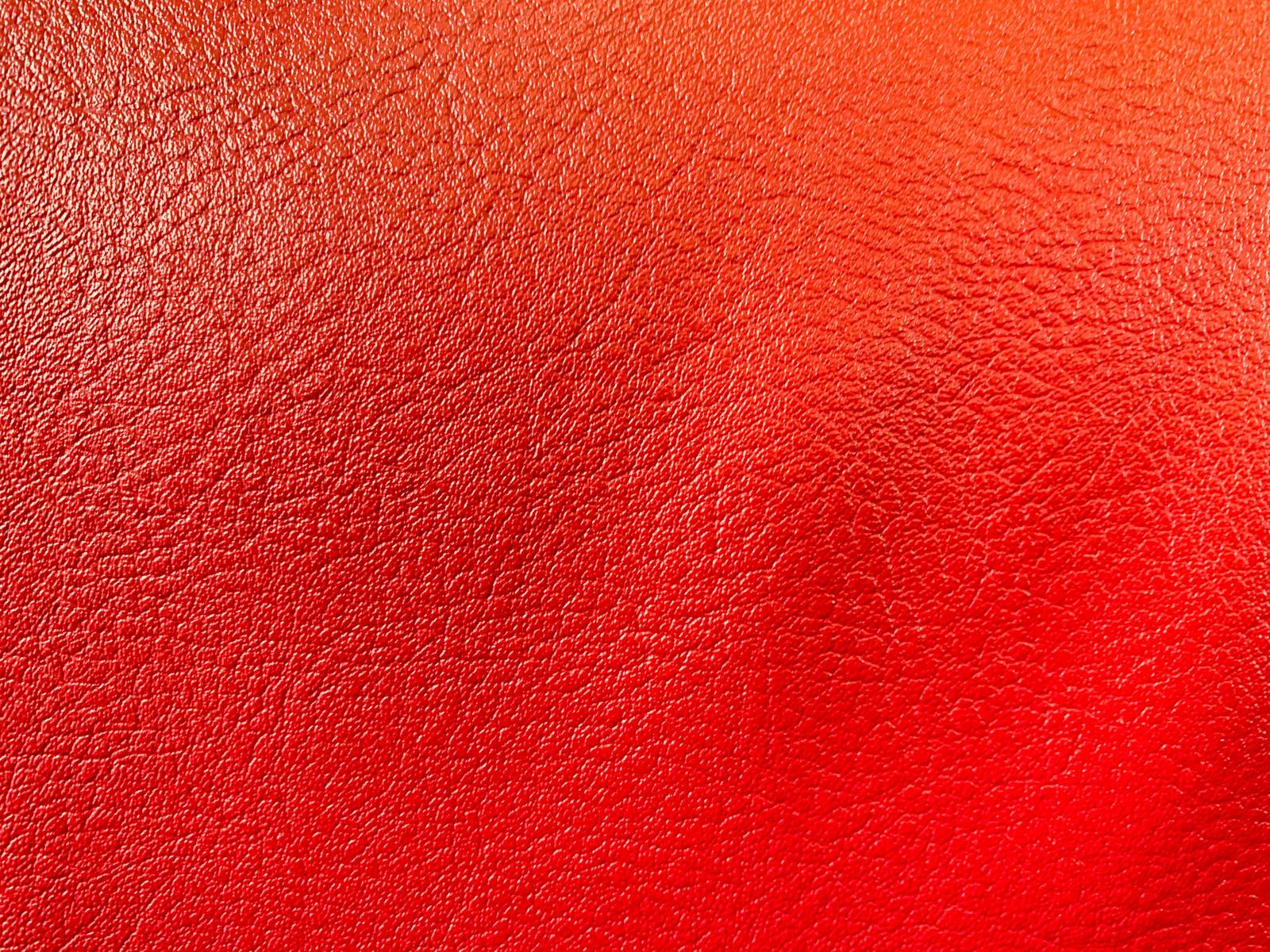 「赤味を帯びる合皮のテクスチャ」の写真