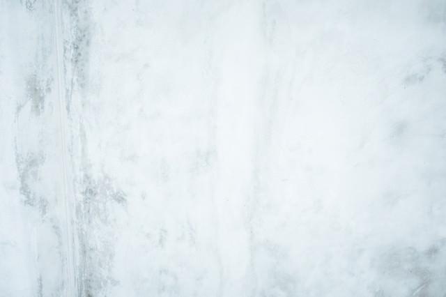 薄汚れたコンクリートの壁(テクスチャ)の写真