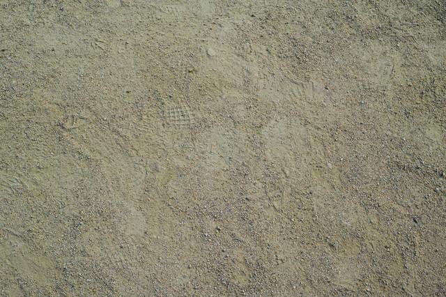運動場に残る足跡(テクスチャ)の写真