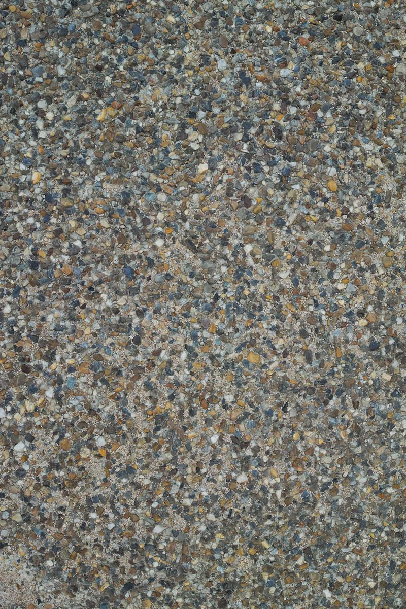 「様々な色や形の砂利敷きの地面(テクスチャ)」の写真