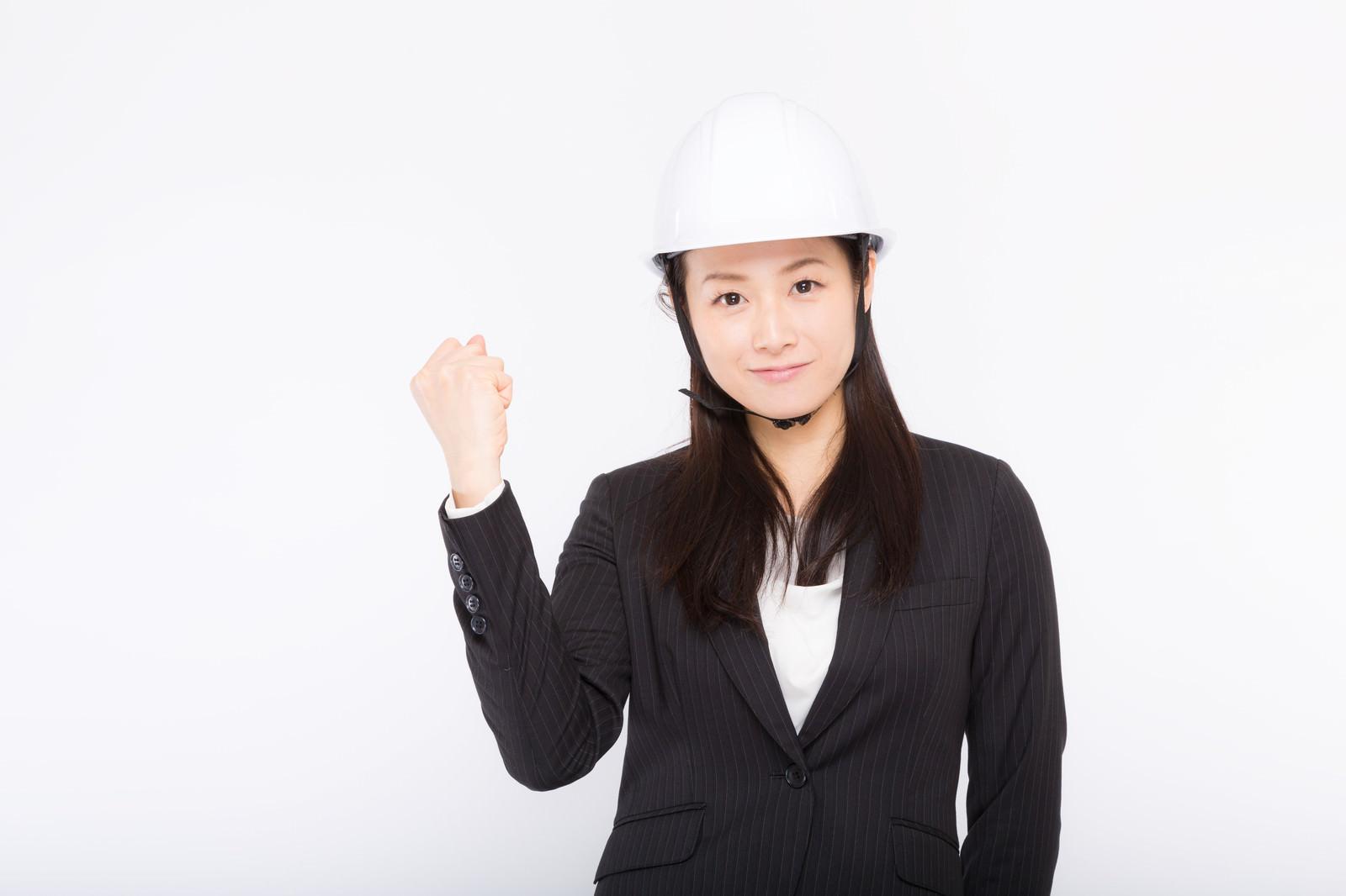 「安全宣言するヘルメットをかぶった女性」の写真[モデル:土本寛子]