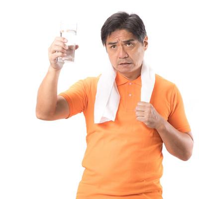「禁酒中につき運動後は決まって水のお父さん」の写真素材